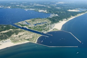Aerial photo of the Muskegon channel from Muskegon Lake into Lake Michigan showing the Harbour Towne condos and marina
